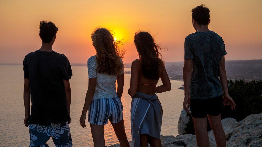 people together enjoying sunset